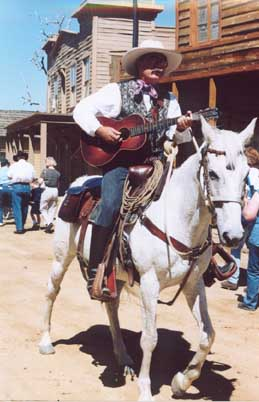 SANTA CLARITA-Melody Ranch-CowboyPoetry-Cowboy On Horse with Guitar-small(cCaroleTerwilligerMeyers)